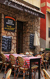Outdoor french traditional cafe in Old Town of Nice Stock Photography