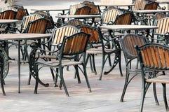Outdoor furniture on a brick patio Stock Photos