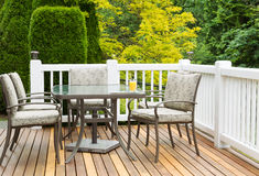 Outdoor Furniture on Cedar Wood Patio during nice day Stock Photography