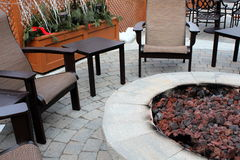 Outdoor furniture and fire pit. Royalty Free Stock Image