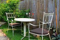 Outdoor furniture in the garden Royalty Free Stock Photos