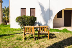 Outdoor furniture. Lounge chairs in hotel garden invite you to relax Royalty Free Stock Images