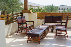 Outdoor furniture rattan armchairs and table on terrace Royalty Free Stock Photos
