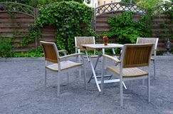 Outdoor furniture with table and four chairs Stock Photo