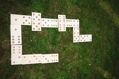 Outdoor games - dominoes, giant outdoor game on green grass.  royalty free stock image
