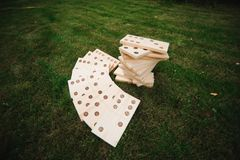 Outdoor games - dominoes, giant outdoor game on green grass.  royalty free stock photos
