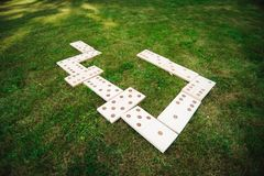 Outdoor games - dominoes, giant outdoor game on green grass.  royalty free stock photography