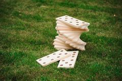 Outdoor games - dominoes, giant outdoor game on green grass.  royalty free stock photo