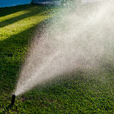 Outdoor garden lawn maintenance sprinkler watering system Royalty Free Stock Photography