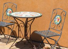 Colorful outdoor table and chairs Stock Photos