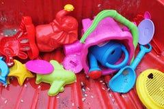 Outdoor garden toys for children in sandpit Stock Image