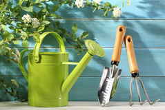 Outdoor gardening tool and flowers Royalty Free Stock Photo