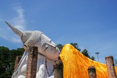 Outdoor giant sleeping buddha image. In blue sky Royalty Free Stock Image