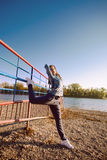 Outdoor girl stretching Royalty Free Stock Photography