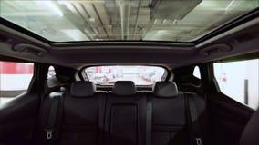 Outdoor glass roof top car cabin. Driving in indoor carpark. stock video