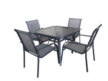 Outdoor glass table and chairs stock photos