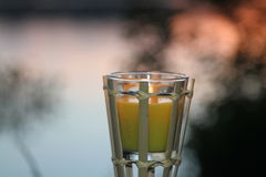 Outdoor glass votives lit in evening Stock Image