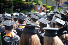 Outdoor Graduation. Students at an outdoor university commencement ceremony. The image orientation is horizontal and there is copy space Royalty Free Stock Photography