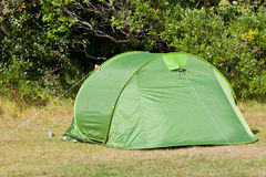 Outdoor Green Tourist Tent at Field Royalty Free Stock Images