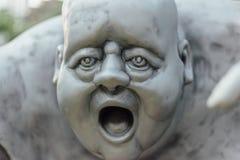 Outdoor Grey Fat Guy Sculpture Stock Image