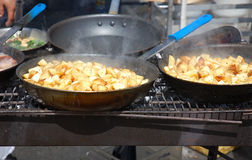 Outdoor grill. Fried potatoes on an outdoor grill stock photos