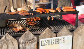 Outdoor grill with ribs and sausages royalty free stock images