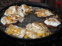 Outdoor Grilled Egg Beefburgers. Australian traditional grilled hamburger and egg servings to go on a bun Stock Images