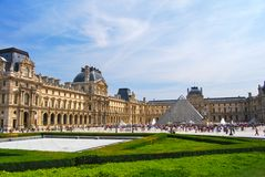 Exterior Grounds Louvre Museum and Pyramid. Outdoor grounds of Musee du Louvre, with the glass pyramid and the classical palace architecture stock images