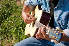 Outdoor guitar player close up Royalty Free Stock Photo