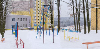 Outdoor gym in winter public park near the apartment complex Royalty Free Stock Images