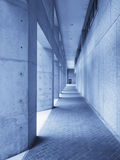 Outdoor hallway in blue. Perspective view of an outdoor hallway in blue leading to a doorway Stock Photography