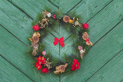 Outdoor hanging Christmas adorn wreath at old Royalty Free Stock Photography