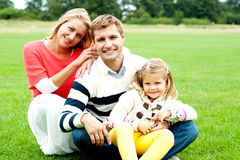 Outdoor happy caucasian family relaxing Stock Images