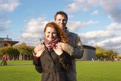 Outdoor happy couple in love, Museum Plein, autumn Amsterdam bac Stock Photo