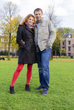 Outdoor happy couple in love, Museum Plein, autumn Amsterdam bac Stock Image