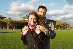 Outdoor happy couple in love, Museum Plein, autumn Amsterdam bac Stock Images