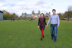 Outdoor happy couple in love, Museum Plein, autumn Amsterdam Royalty Free Stock Photography