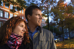 Outdoor happy couple in love posing against autumn Amsterdam bac Stock Images