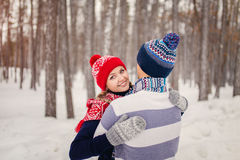 Outdoor happy couple in love posing in cold winter weather. Young boy and girl having fun outdoor Royalty Free Stock Image