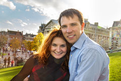 Outdoor happy couple in love posing in Museum Plein, autumn Amst Royalty Free Stock Photo