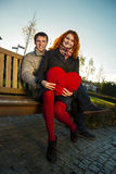 Outdoor happy couple in love posing in Museum Plein, autumn Amsterdam Stock Photography
