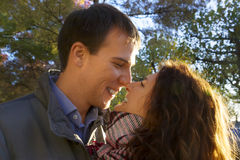 Outdoor happy couple in love posing in Museum Plein, autumn Amsterdam Royalty Free Stock Photo