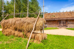 Outdoor hay drying construction near old barn Royalty Free Stock Image