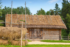 Outdoor hay drying near old wooden barn Stock Photo