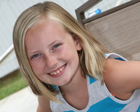 Outdoor head shot of a 9 year old girl Stock Photos