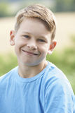 Outdoor Head And Shoulder Portrait Of Smiling Boy Stock Photography