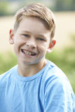 Outdoor Head And Shoulder Portrait Of Smiling Boy Royalty Free Stock Image