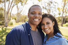 Outdoor Head And Shoulders Portrait Of Couple In Park royalty free stock photography