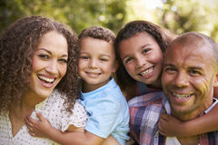 Outdoor Head And Shoulders Portrait Of Family In Garden royalty free stock photos