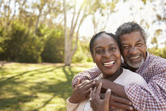 Outdoor Head And Shoulders Portrait Of Mature Couple In Park Stock Image